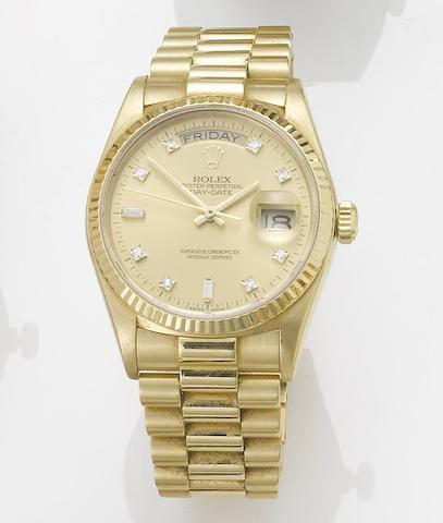 Rolex. A fine 18ct gold diamond set automatic centre seconds calendar bracelet watch together with fitted presentation box and papers Day-Date, Made in 1987, Sold October 27th 1988