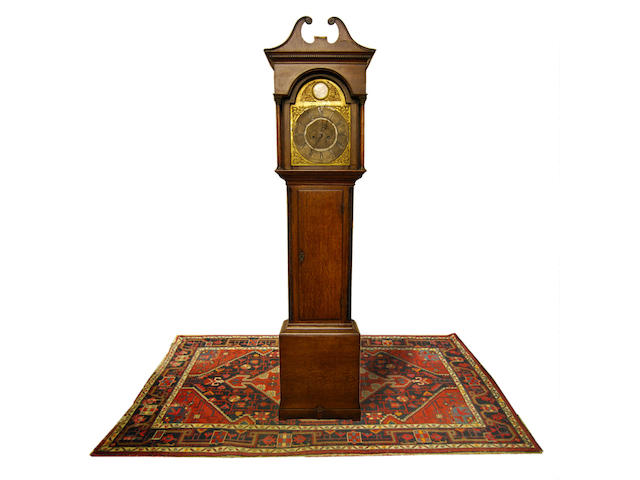 A George III oak-cased eight-day brass dial longcase clock with centre calendar sweep, circa 1780 J Atkinson, Gateshead