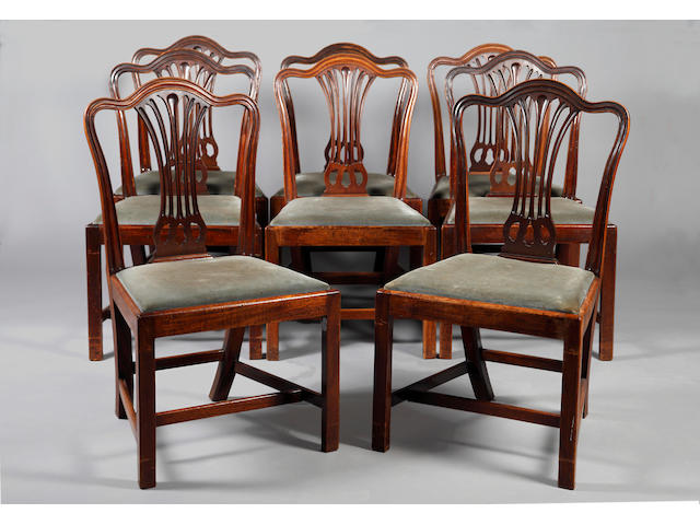 A matched set of eight George III Hepplewhite design dining chairs,