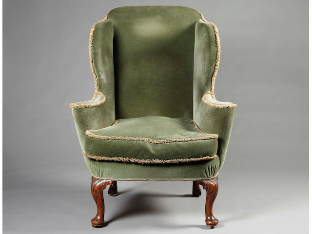 A George II style walnut and upholstered chair