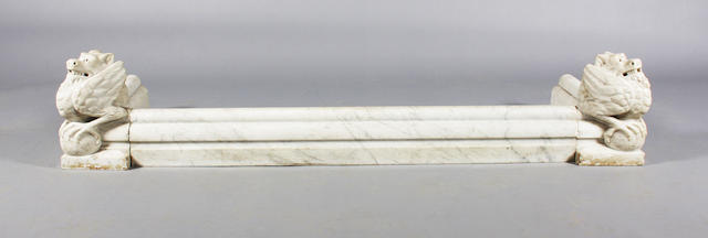 A late 19th century white marble fireplace kerb