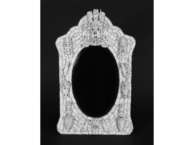 A late 19th century Dieppe carved ivory and bone framed wall mirror