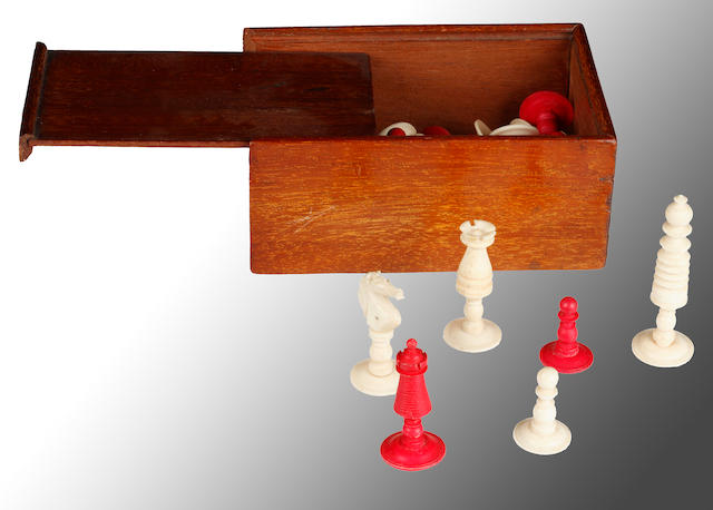 A Staunton pattern small natural ivory and red stained chess set, (Damaged), a small natural bone and red stained barleycorn type chess set and a Staunton wood chess set. (parcel)