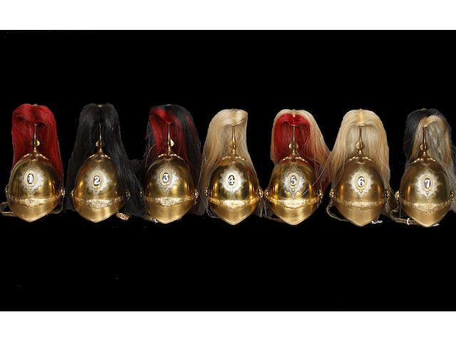 Seven Miniature Brass Household Cavalry Helmets