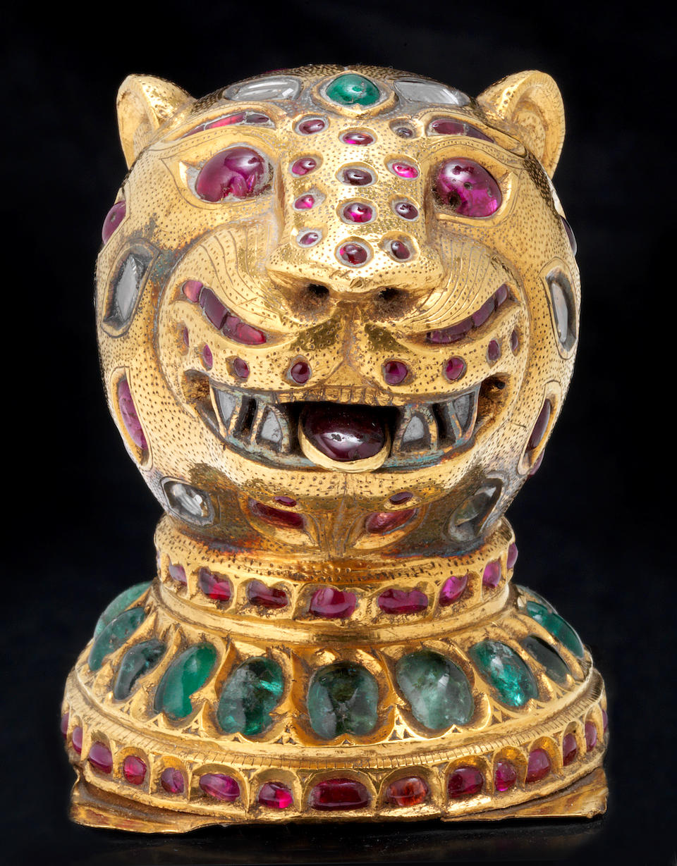An important gem-set gold Finial in the form of a Tiger's Head from the throne of Tipu Sultan (1750-99) Mysore (Seringapatam), made between 1787-93