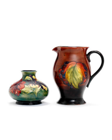 Walter Moorcroft 'Leaf and Berry' a flambé jug, circa 1950 together with a small squat vase in 'Hibiscus'