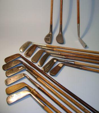 A quantity of early 20th Century putters in a golf bag