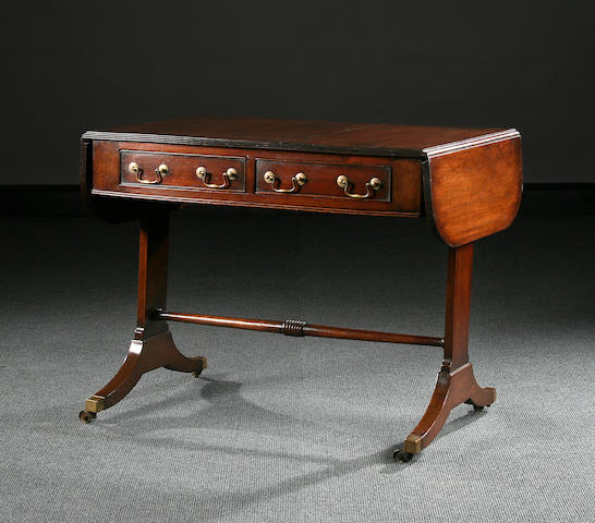 A mahogany sofa table, early 19th Century