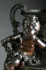 A large bronzed spelter and variegated marble mantel clock and garnitureJapy Freres, Paris, circa 1900