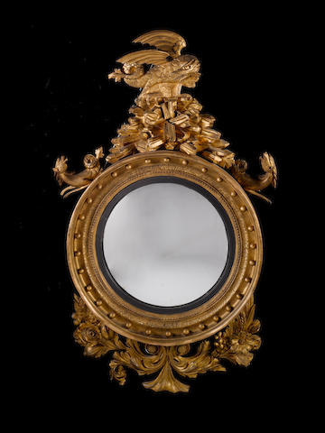 A large Regency mahogany Convex Mirror