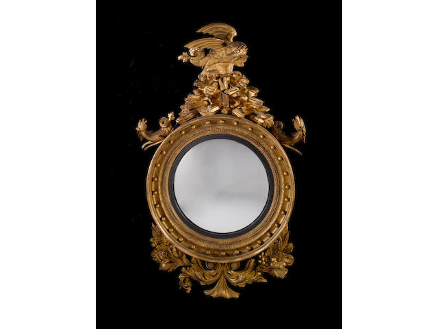 A large Regency mahogany convex mirror