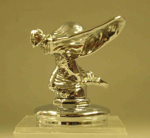 A Rolls-Royce kneeling Spirit of Ecstasy mascot,