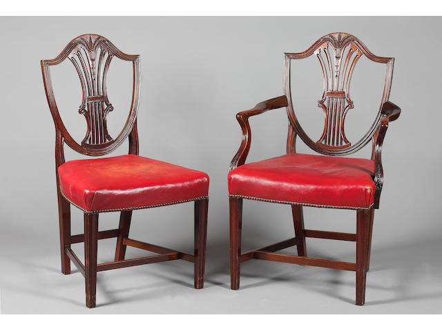 A set of eight Hepplewhite style mahogany dining chairs