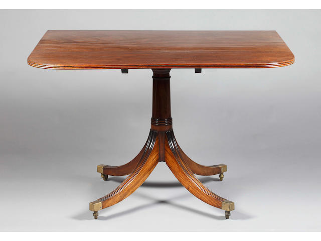 A George III style triple pillar dining table