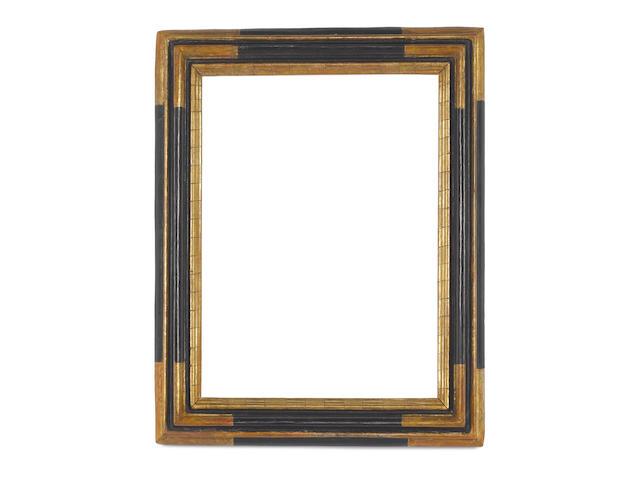 An Italian 17th Century carved, ebonised and parcel gilt frame