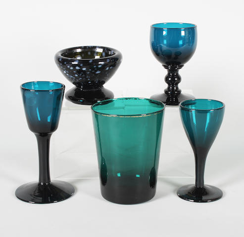 Three turquoise-tinted wine glasses, a green tinted beaker and a Nailsea-type bowl Late 18th and early 19th Century.