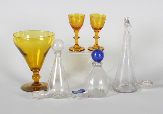 An amber-tinted wine glass, a pair of amber-tinted cordial glasses, and three bird feeders Late 18th Century and early 19th Century.