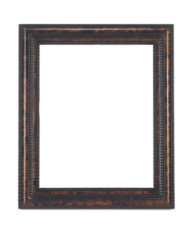 A Dutch 19th Century ebonised and tortoiseshell ripple moulding frame