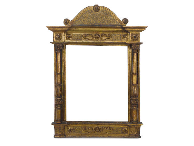 An Italian 16th Century carved, gilded and polychromed tabernacle frame