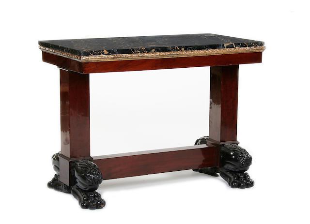 An Italian Empire style mahogany centre table
