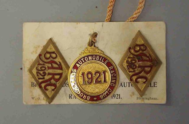 A set of 1921 BARC badges,