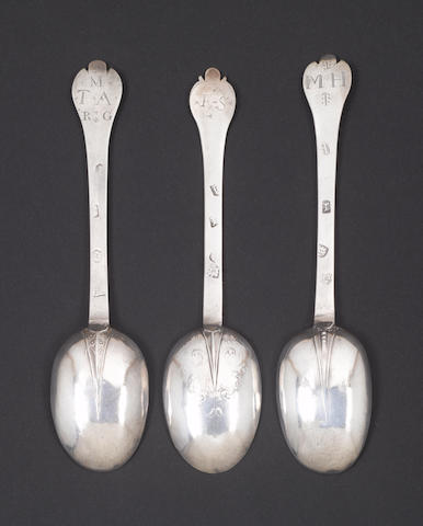 A Charles II silver lace-back trefid spoon, by Lawrence Coles, London 1683, together with two other