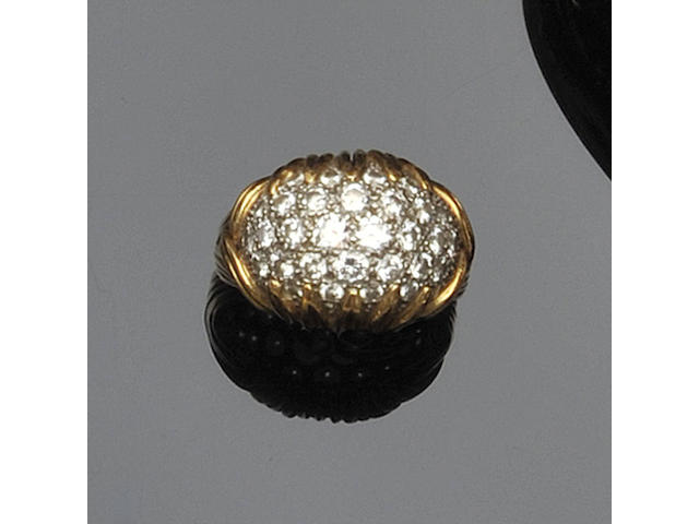 A bombé diamond ring, by Boucheron,
