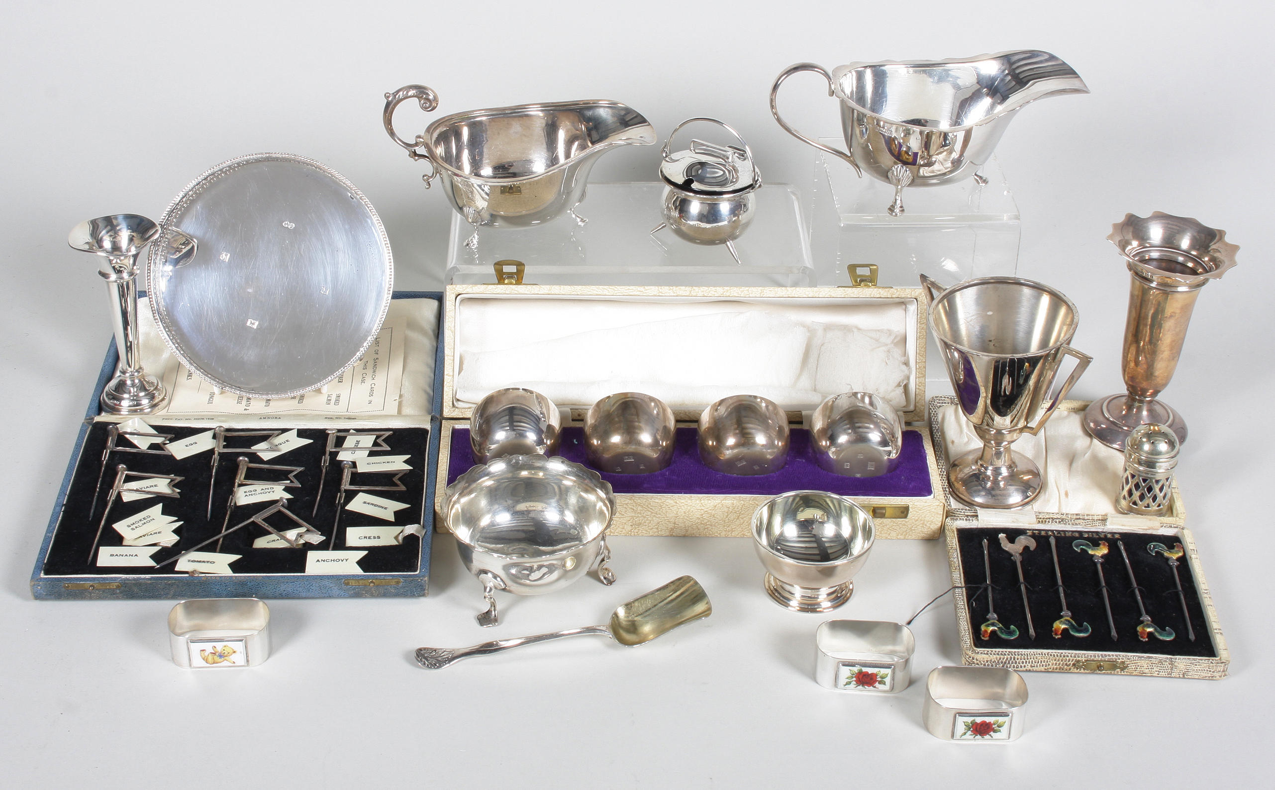 A set of four silver tumbler cups