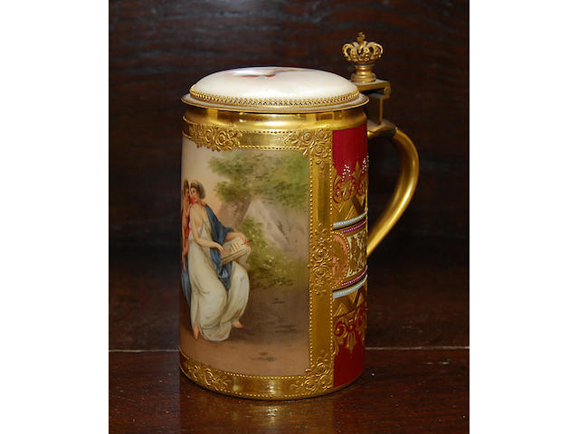 A continental painted tankard Of cylindrical form, the body decorated with classical scenes of maiden and putti against a naturalistic background within gilt relief borders, the hinged cover painted portraying an 18th Century lady, the gilt metal handle with crown finial