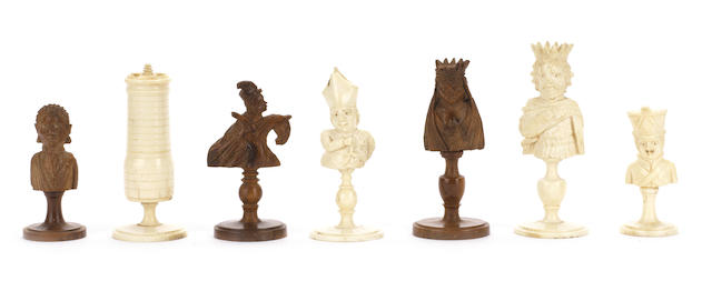 "A bone and coquilla nut ""bust"" chess set, Dieppe, circa 1810,"