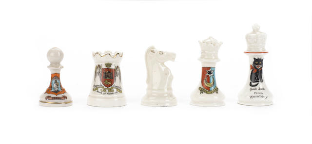 """A collection of """"Staunton Pattern"""" porcelain chessmen, by and in the style of Arcadia, circa 1920,"""