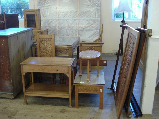 Furniture by Hubert Clements in carved oak