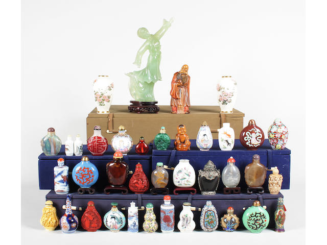 A collection of Chinese snuff bottles and stoppers, a carved hardstone figure, two carved hardwood figures and a small pair of Japanese Satsuma vases 20th Century.