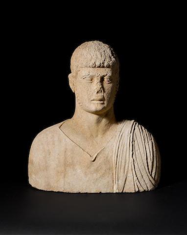 A Roman limestone funerary male bust