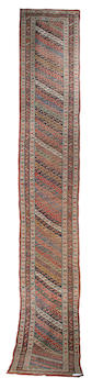 A Kurdish runner West Persia, 21 ft 4 in x 3 ft 4 in (650 x 102 cm)