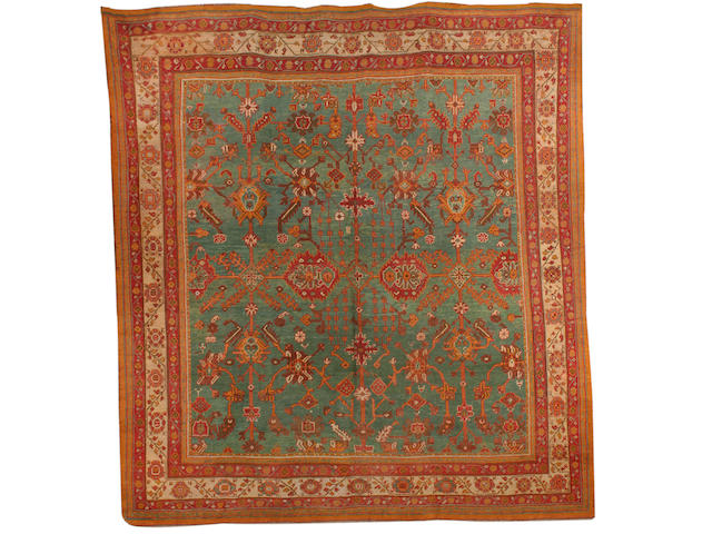 An Ushak carpet West Anatolia, 11 ft 6 in x 10 ft 10 in (350 x 330 cm) some minor restoration