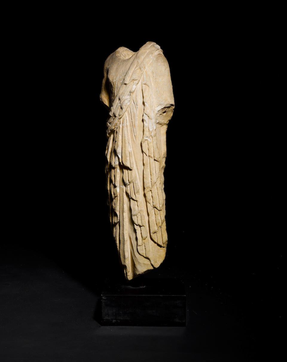 A Roman marble archaistic kore