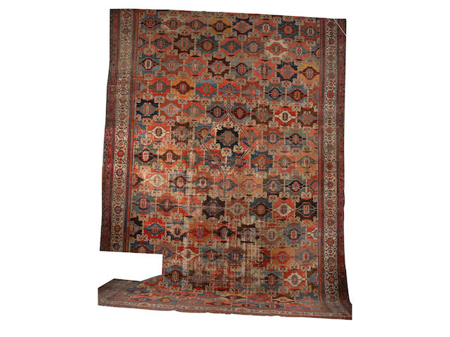 A large Malayir carpet West Persia, 23 ft 9 in x 15 ft 6 in (724 x 474 cm) reduced in size some damage