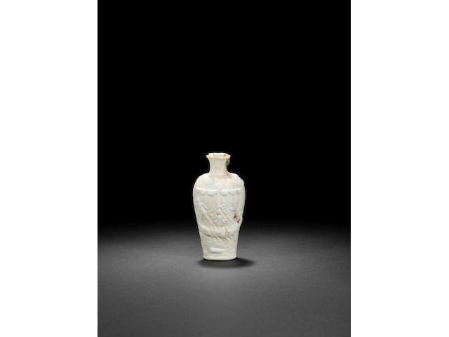 A Roman opaque white mould-blown 'Ajax' glass amphoriskos