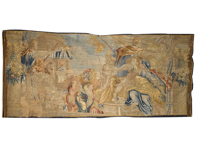 A late 17th / early 18th century Brussels tapestry, depicting The Rape of the Sabine Women 16ft 11 in x 7 ft 2 in (515 x 217cm) some damage and restoration, lacking borders on three sides