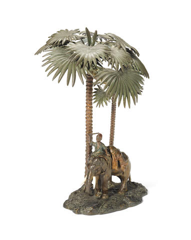 Franz Bergman (Austrian, 1861-1936): A cold painted bronze table lamp in the form of a boy astride an elephant