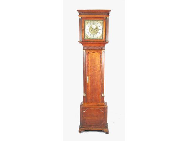 A George III oak and mahogany crossbanded longcase clock