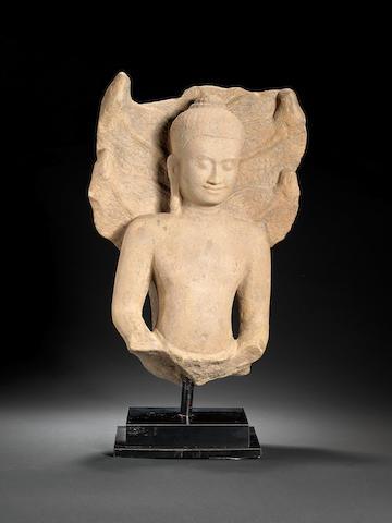A sandstone figure of Buddha Muchalinda Cambodia, Angkor Period, Bayon Style, 13th century