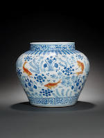 A rare enamelled and blue and white 'fish' jar, guan Jiajing six-character mark and of the period