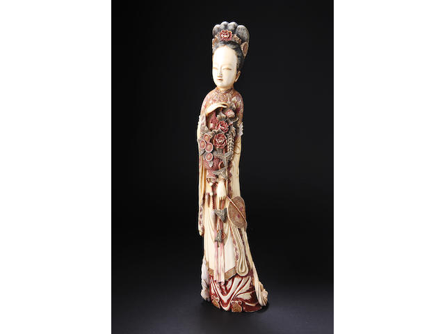 A large stained ivory figure of a court lady Circa 1900,