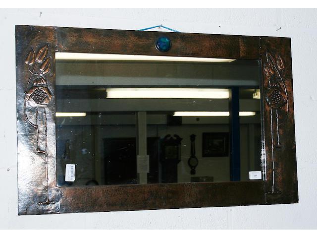 An Art Nouveau copper mirror