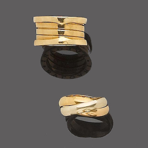 A gold dress ring, by Bulgari and a 'Trinity' ring, by must de Cartier (2)