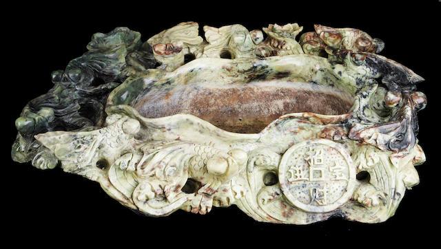 A massive Chinese soapstone basin
