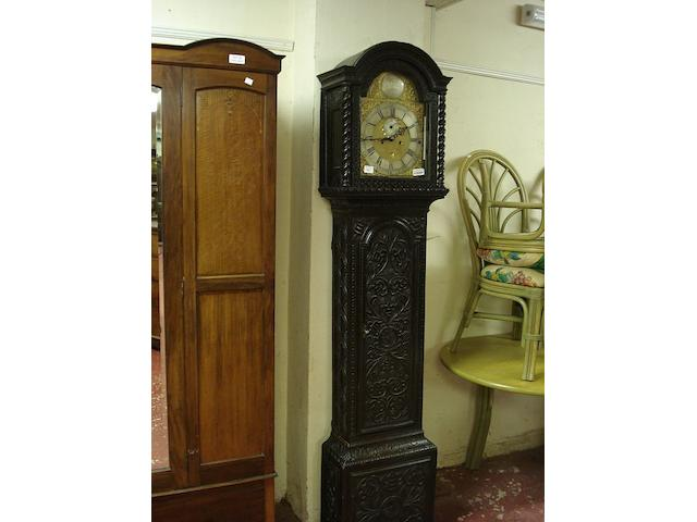 A carved oak cased eight day longcase clock J Chiltors, London