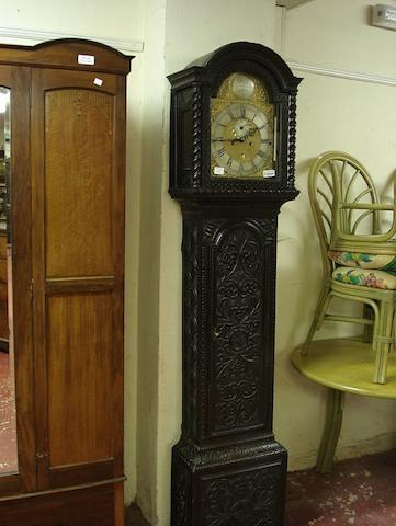 A carved oak cased eight day longcase clock J Chiltors, London